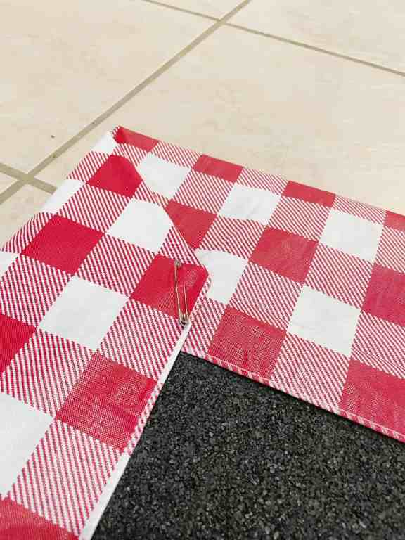 Use a safety pin to secure the the corner and then move on to the other three corners.