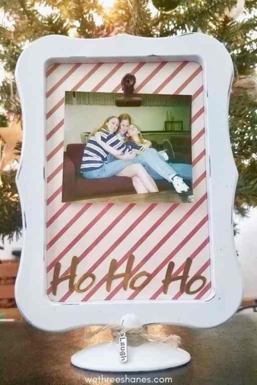 Making this DIY Ho Ho Ho picture frame for your friend this holiday season. It's a fun, budget-friendly Christmas gift. | We Three Shanes