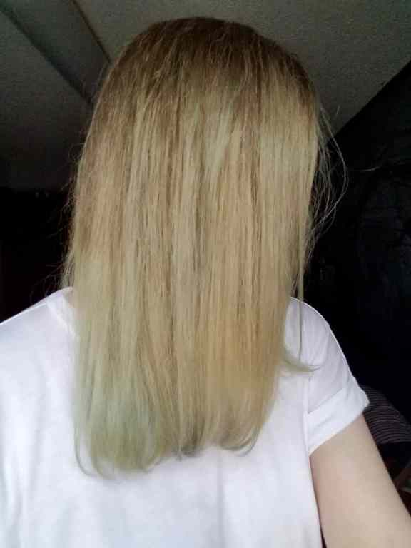 A side view of my hair after using OvertoneVibrant Silver shows very blotchy hair with streaks of green/grey color in different parts of my hair especially at the ends. Lots of blonde hair with no color deposited.