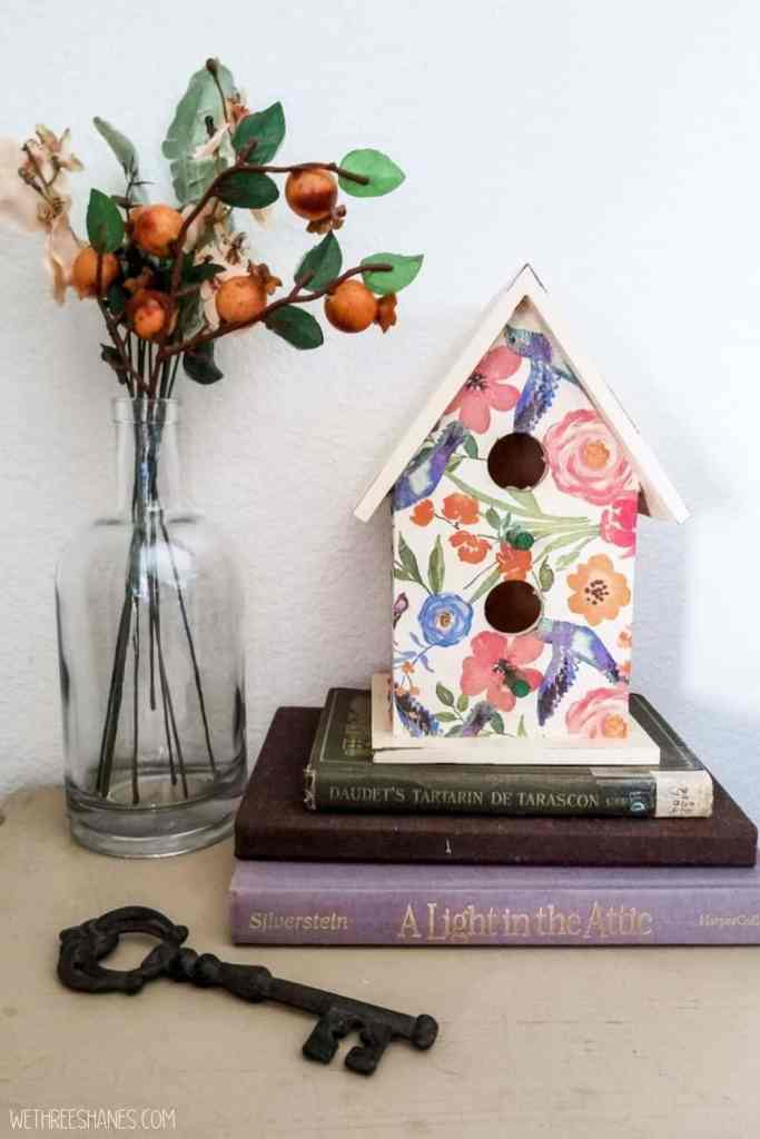 Learn how to decoupage a birdhouse with napkins. A fun spring decor craft. | We Three Shanes