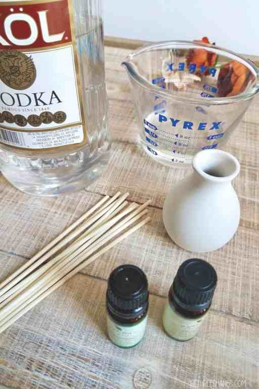 Store bought reed diffusers can get pretty expensive. Learn how to make your own for less and fill your space with a lovely, natural scent. | We Three Shanes