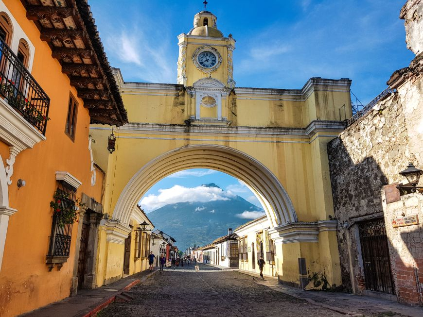 Santa Catalina Arch in Antigua Guatemala with Volcan de Agua in the background.