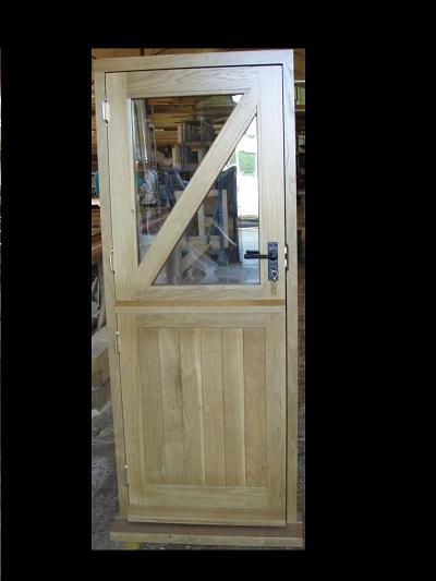Oak stable door glazed top halve with diagonal top brace