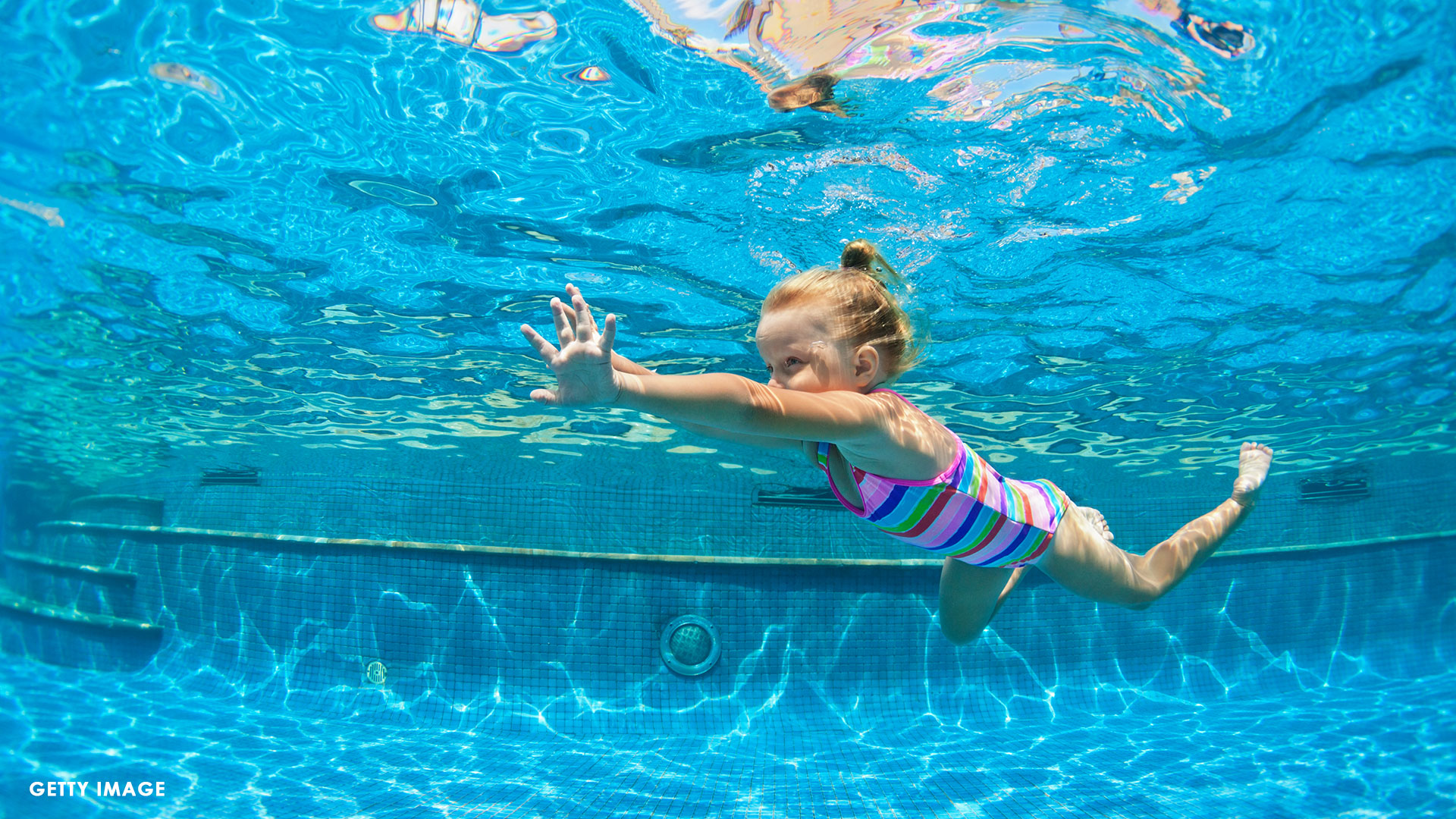 swimming-child_1558643593415.jpg