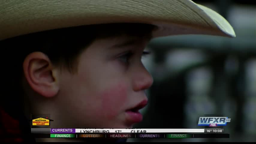 A 3 year old gets the VIP treatment at the rodeo_13470731