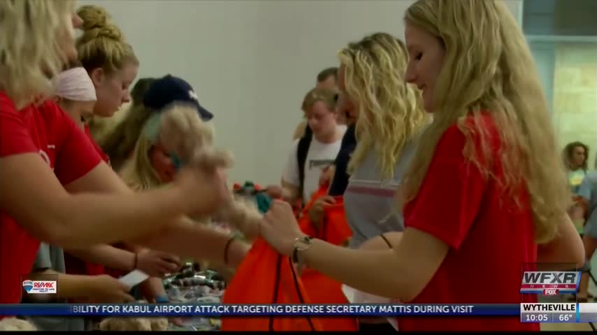 Students pack kits for sexual assault victims_84462132