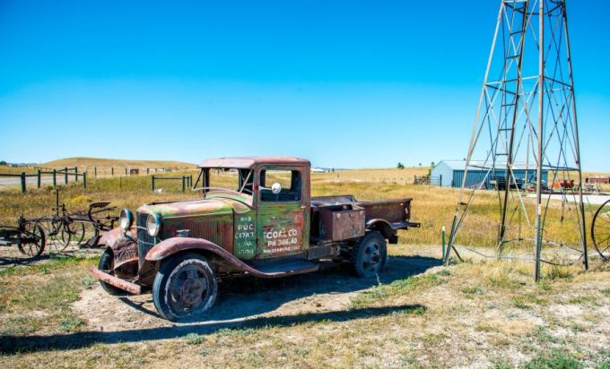 Old Rusty Ford truck in a field on September 14th 2018 close to Cheyenne Wyoming.