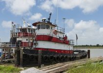 An old and rusty tugboat at Lake Charles, Louisiana, USA.