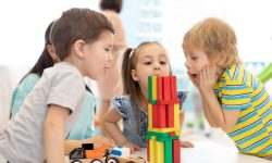 Little kids build wooden toys at home or daycare.