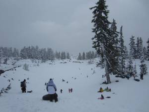 The sledding bowl at Mount Baker is a winter wonderland. The landmark chalet can be seen in the background.