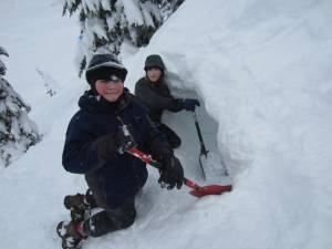Bellingham friends Asa Row and Max Duryee take a break from sledding at Mount Baker to dig their snow cave.