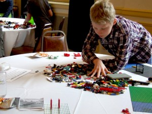 Whatcom County 12-year-old Lute Davis searches for the perfect pieces to bring his imagination into reality at an Inner Child Studio Build-Off. Photo courtesy: Rachel Andrews.