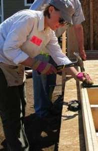 Alyssa Carpenter helps build Habitat for Humanity homes through the Women Build program. Photo courtesy: Habitat for Humanity.