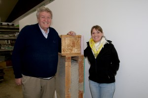 John Moon, Executive Director, and Alyssa Carpenter, Women Build leader, stand next to the insulating model that helps keep Habitat for Humanity homes energy efficient. Photo credit: Theresa Golden.