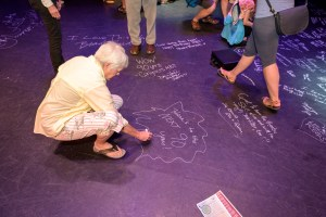 Mount Baker Theatre patrons became a part of history by signing the stage at the MBT summer event. Photo courtesy: Mount Baker Theatre.
