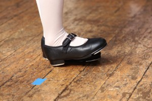 Kids learn that tap dance is learning an instrument that happens to be on your feet. Photo credit: JmWorks.