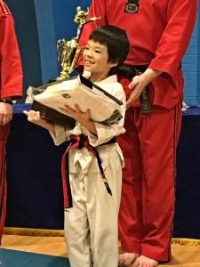 Tommy Geng receives his black belt in Taekwondo at age eight. Photo credit: Dondi Tondro-Smith.