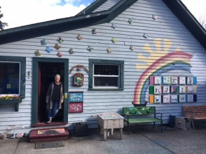 Pam Sinnett hovers in the doorway of one of the school house classrooms at Samish School. Photo credit: Dondi Tondro-Smith.