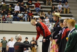 Brisen receiving his medal after winning the 50 free. Photo credit: Grant Clark.