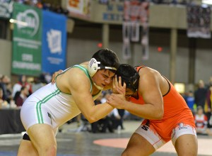 Blaine junior Saul Magallon (right) during his 220-pound state semifinal match against Tumwater's Caden Hicks. Magallon would go on to win his first state championship. Photo credit: Grant Clark.