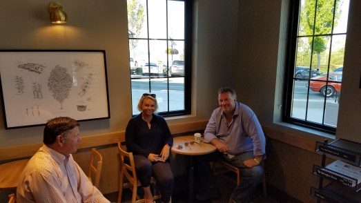 Mike and Skye Hill pictured with local real estate broker, Mike Kent, at the new Starbucks grand opening. Photo credit: Bill Schwartz.