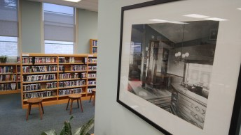 A reminder of the library's past contrasts with the current selection of DVDs. Photo courtesy: Steven Arbuckle.