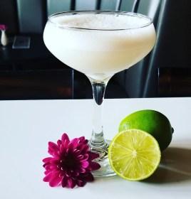 The Cacharetto Sour cocktail combines Novo Fogo Brazilian Cachaca, Saliza Amaretto, organic lemon and egg white. Photo credit: Allie Sutherland.