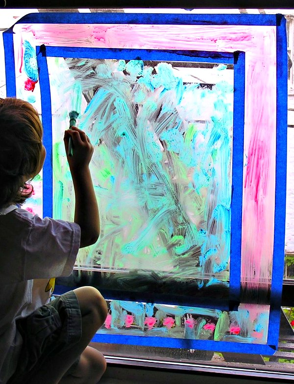 Window painting is a fun indoor activity for kids during rainy days
