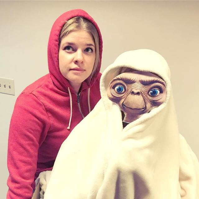 ET phone home reigning office party costume champs