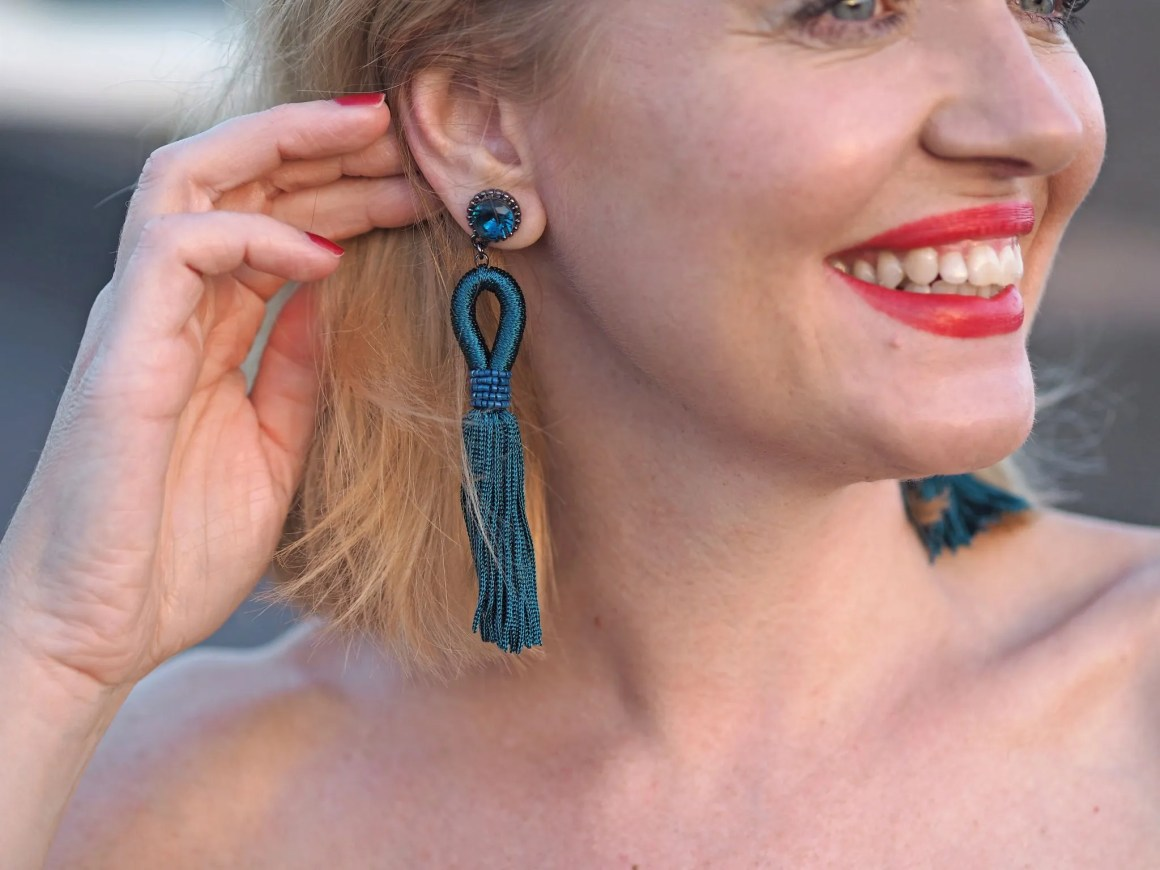 what lizzy loves turquoise tassel earrings and floral jumpsuit