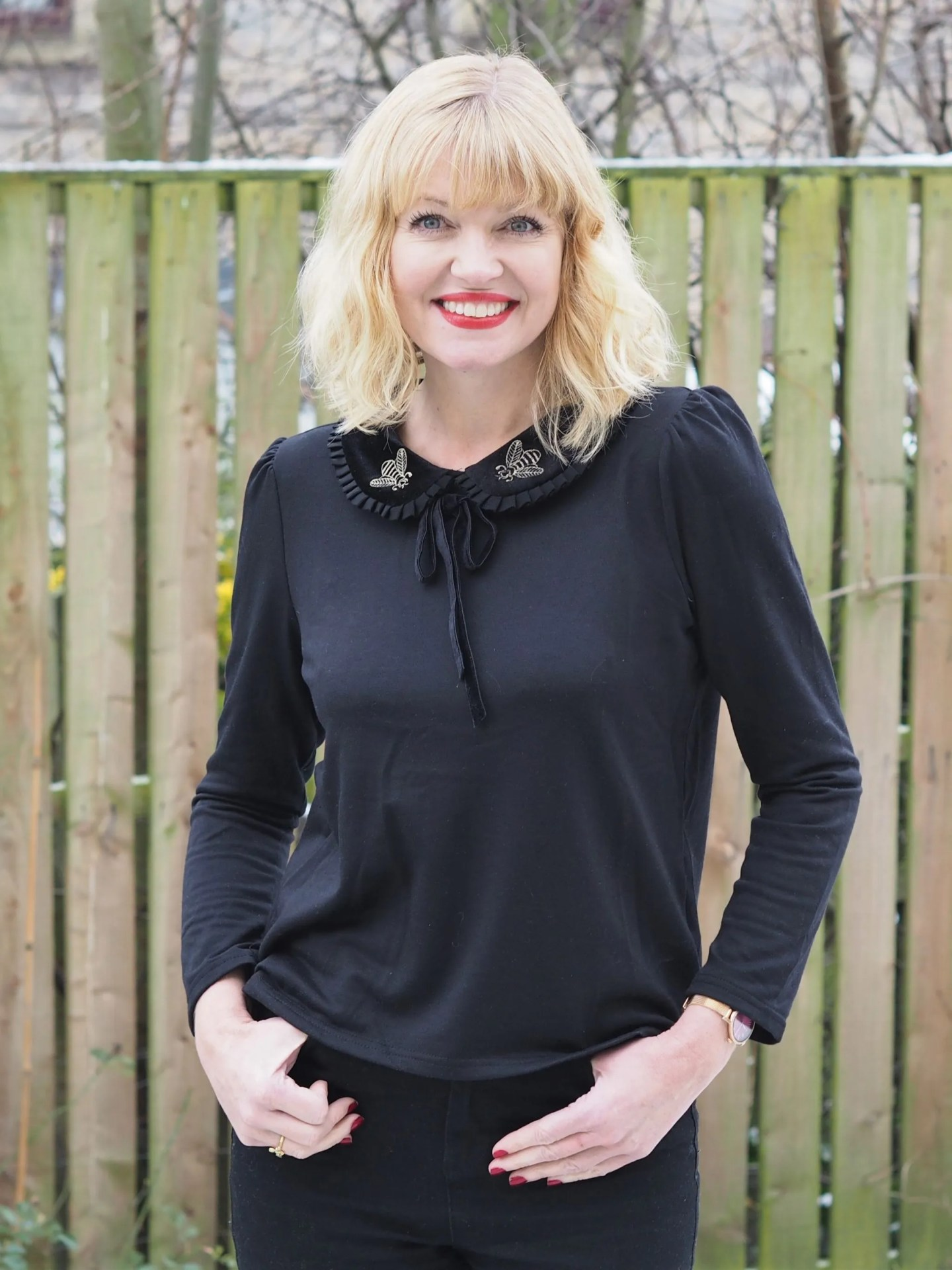 What Lizzy Loves embroidered bee top, black pom pom jeans, fishnet socks with shoes
