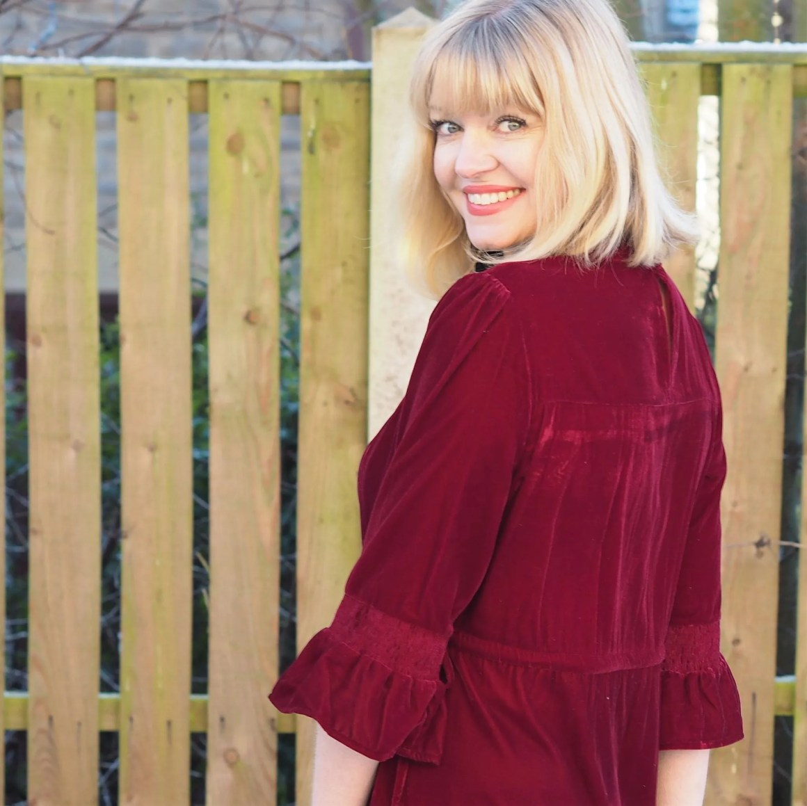What Lizzy Loves red velvet midi dress back detail