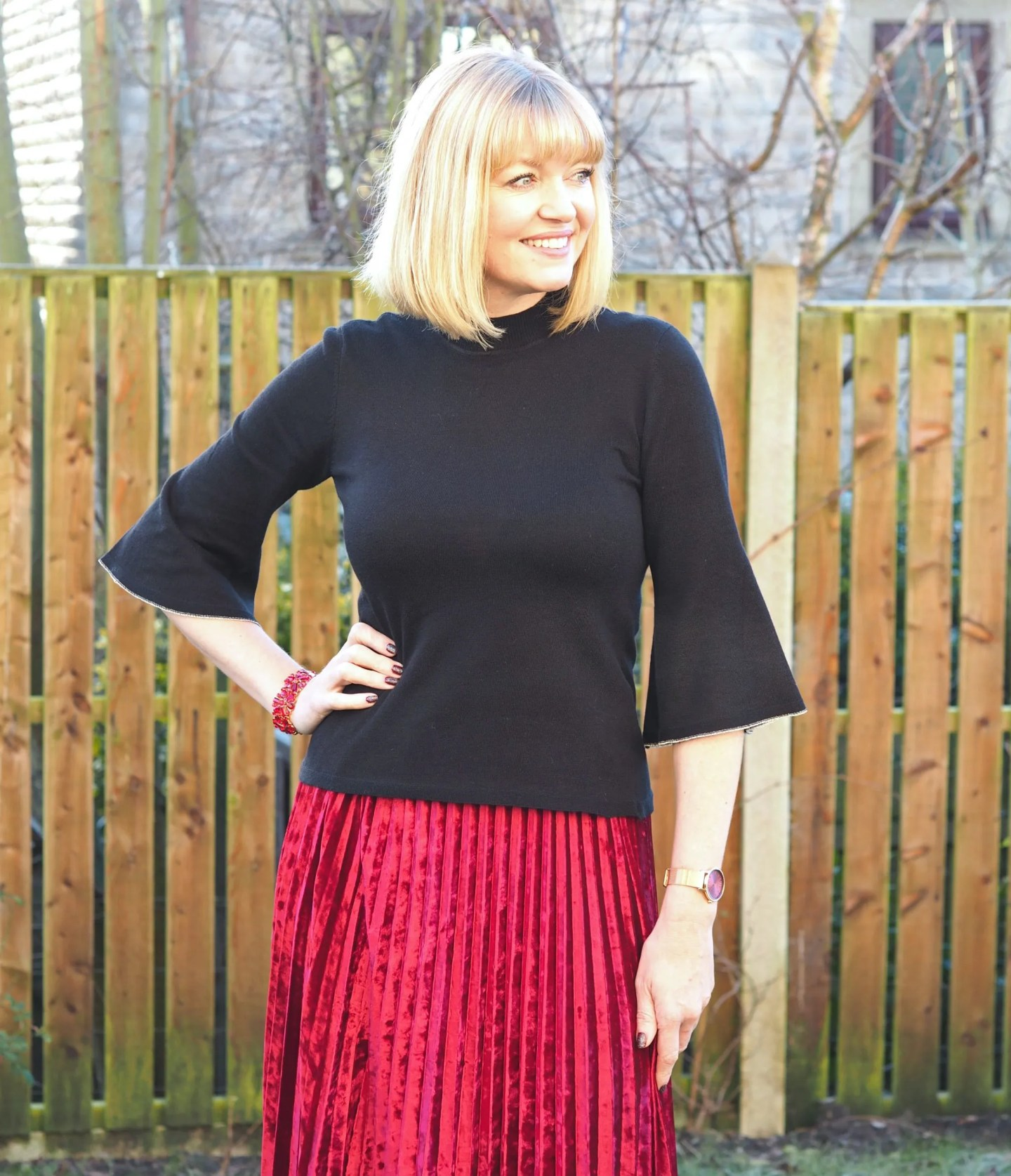 What Lizzy Loves black fluted edge top and red velvet pleated skirt