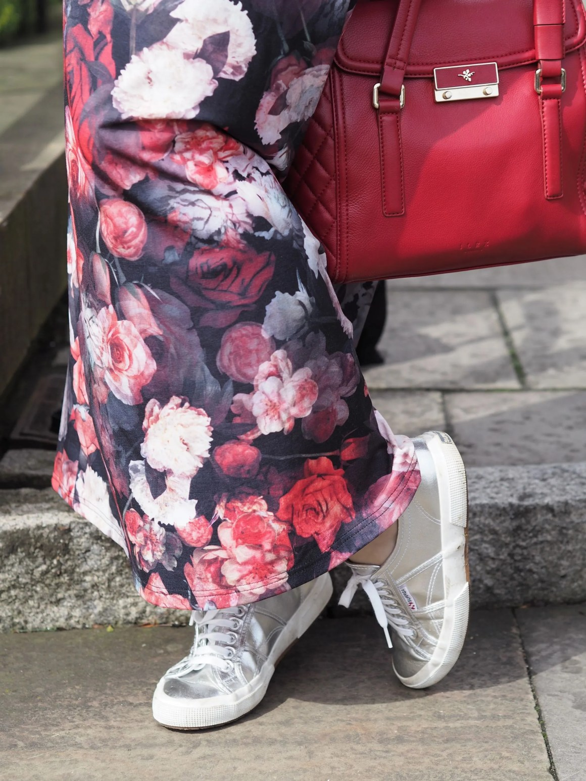 floral maxi dress silver sneakers red bag
