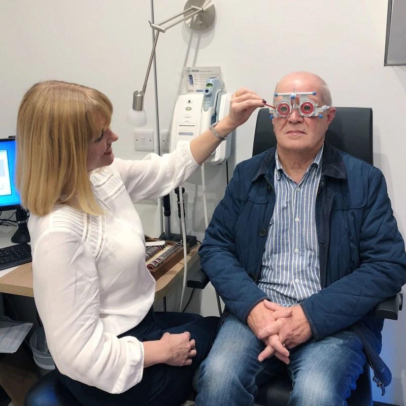 optometrist performing eye test