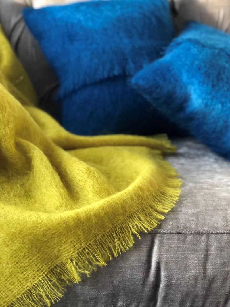 mustard mohair throw and mallard-coloured cushions