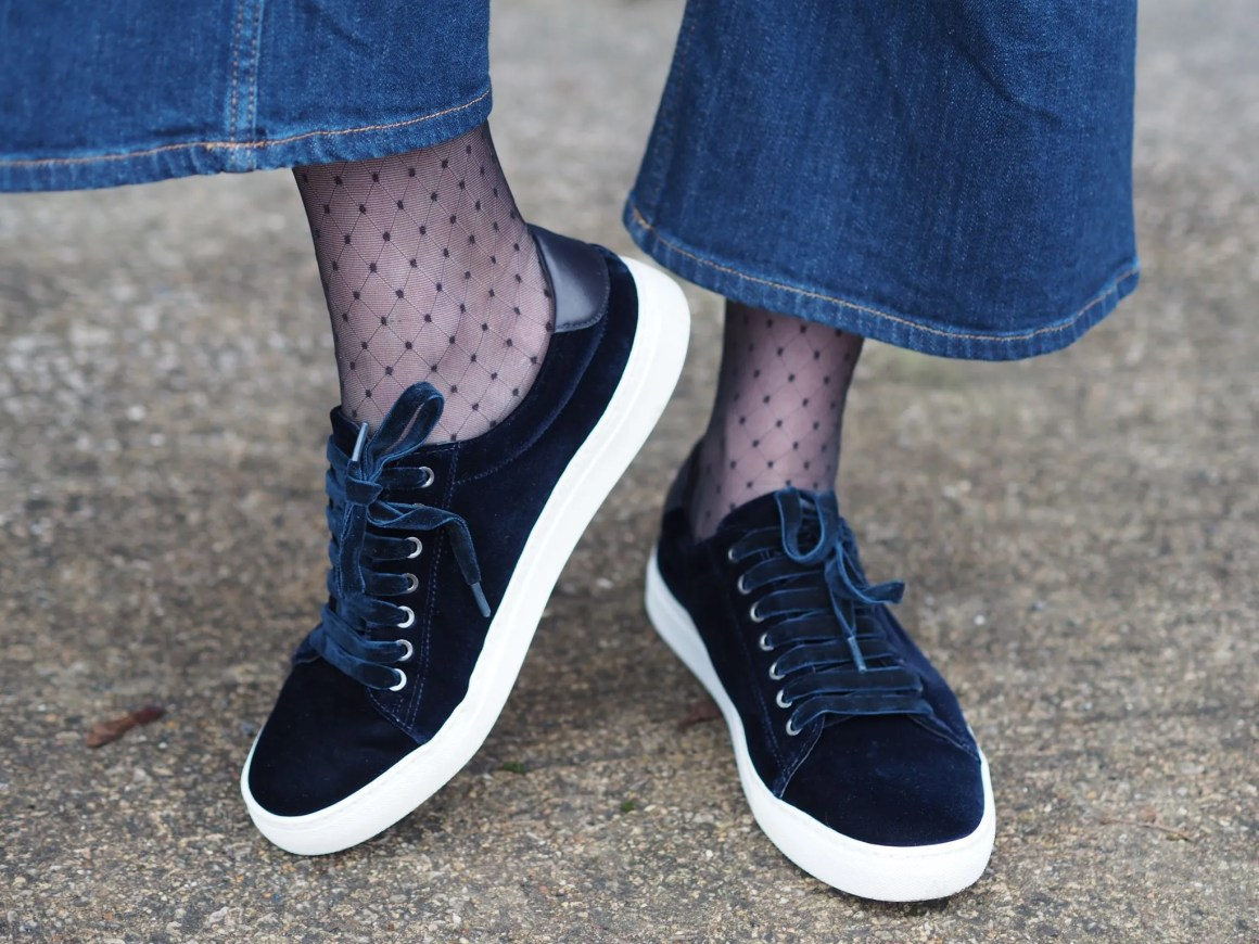 navy velvet trainers with knee high patterned socks and wideleg jeans