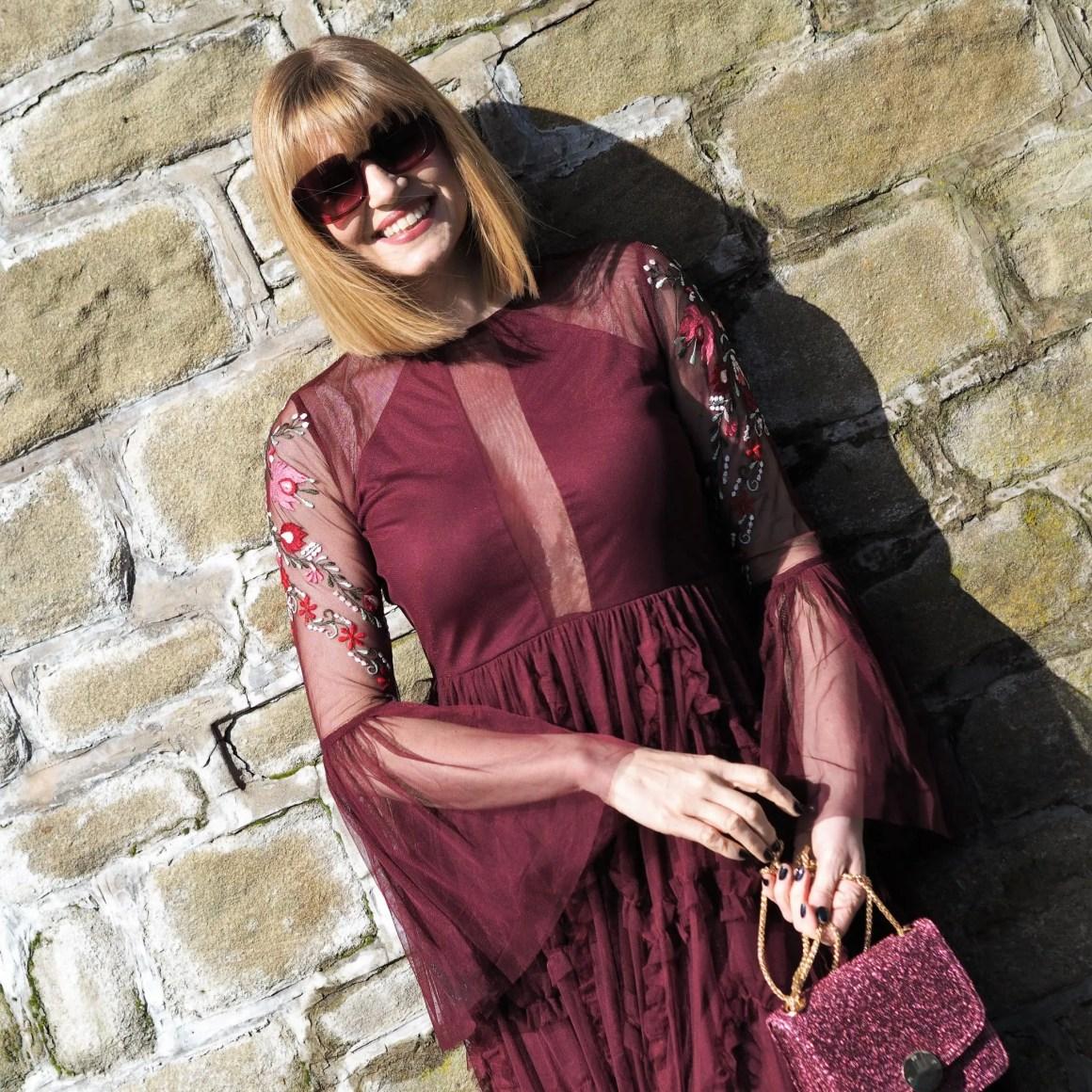 berry ruffled maxi dress and square sunglasses