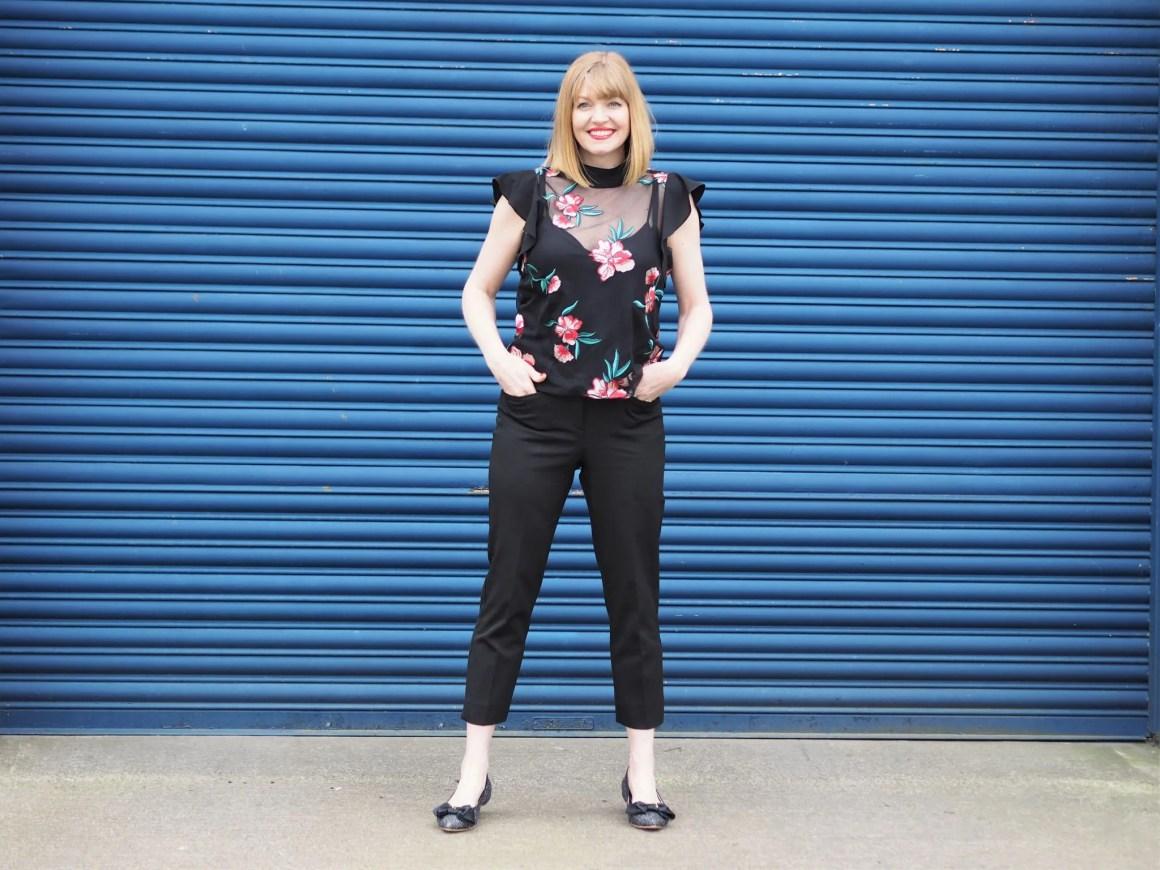 Black cigarette pants floral top glitter ballerinas