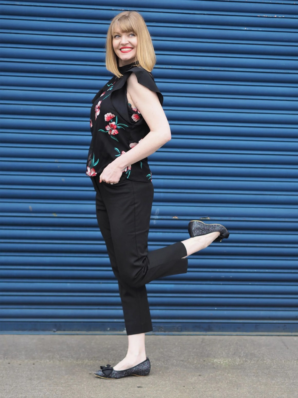 Black cigarette pants floral top glitter ballerinas