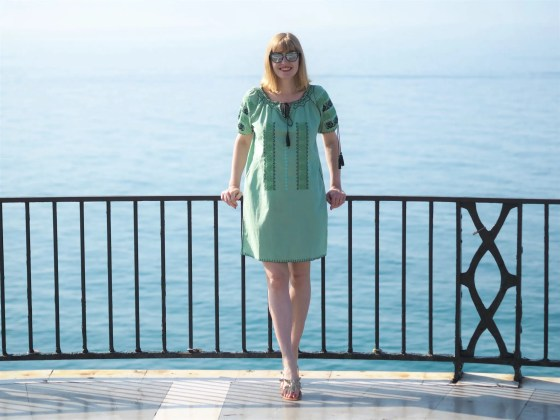 Green embroidered beach dress and green cat eye sunglasses el Balcon de Europa