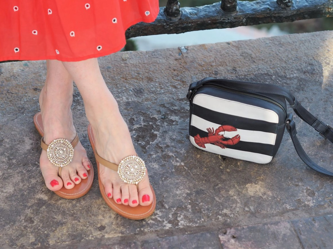 striped lobster bag and beaded sandals