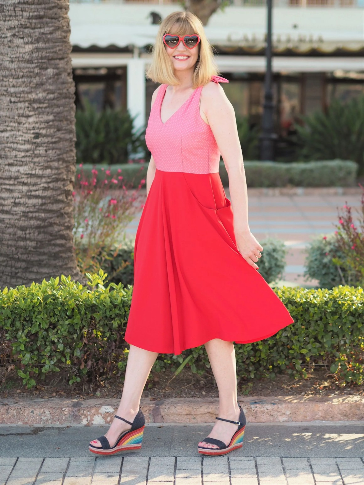 red and pink fifties sundress with rainbow wedge sandals