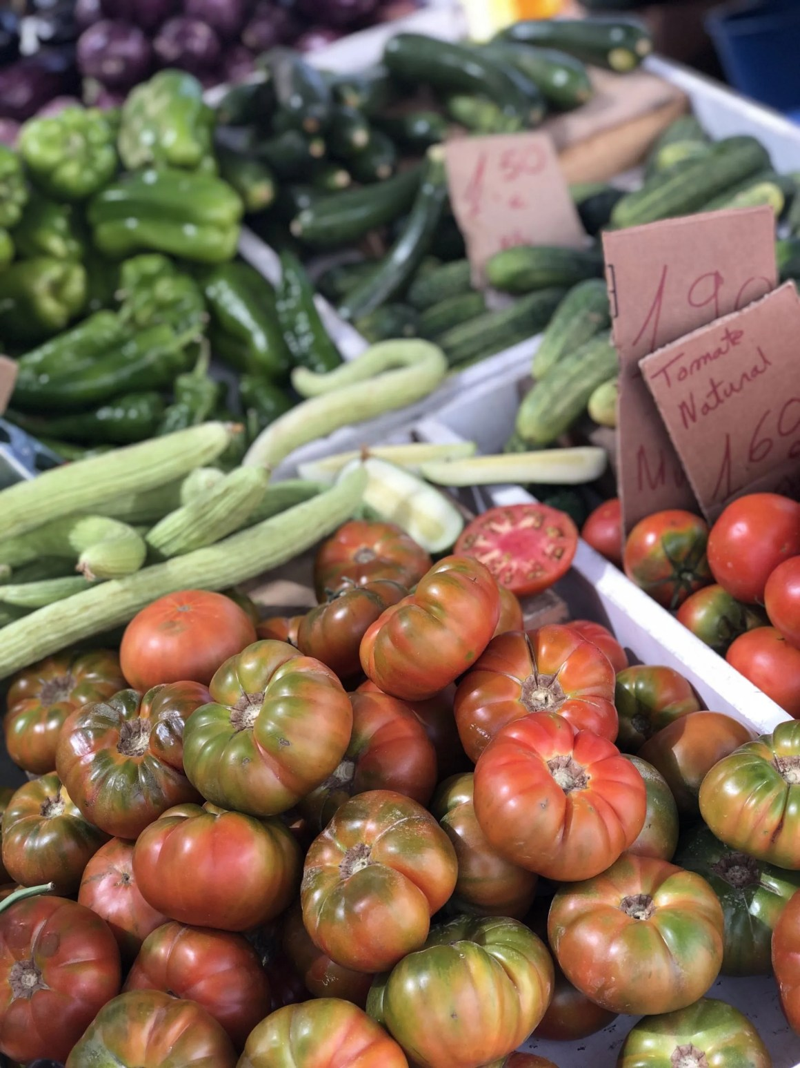 tomatoes and courgettes at market