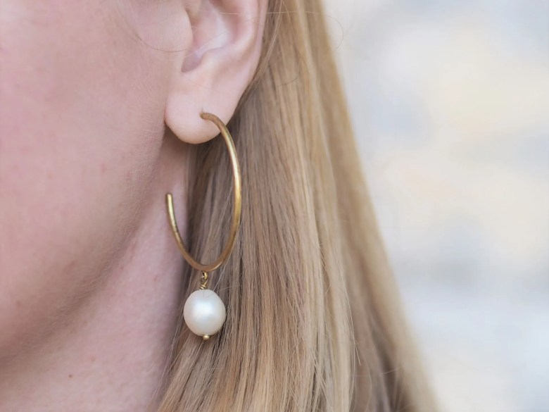 Gold and pearl hoop earring