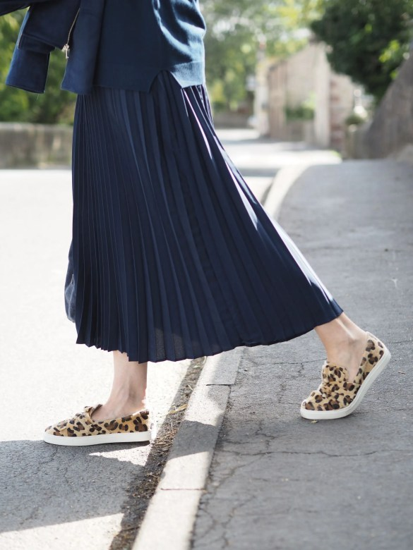 Leopard print pull on trainers and navy skirt