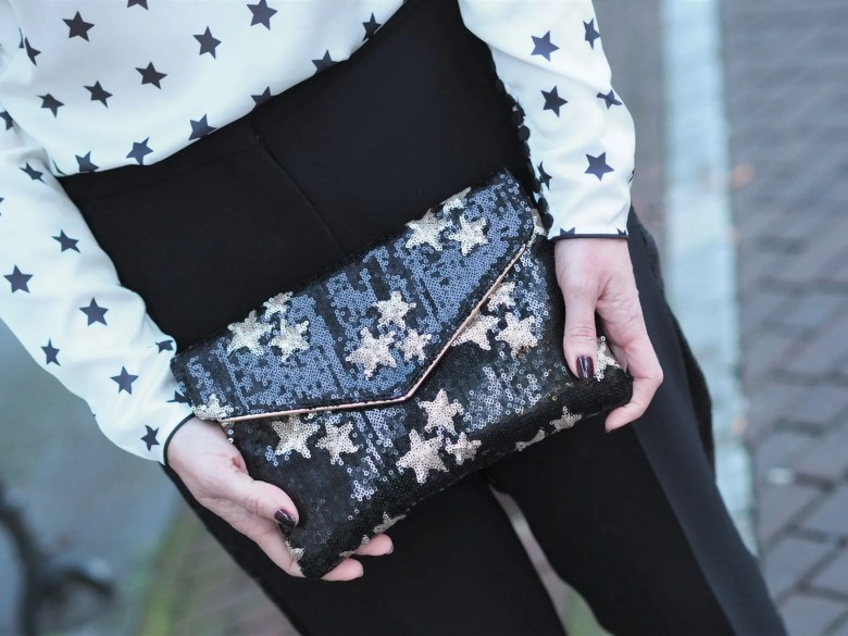 black and gold sequin star bag