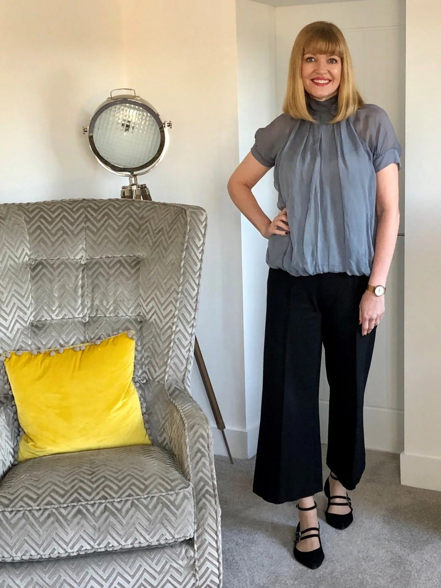 grey blouse and navy wide trousers