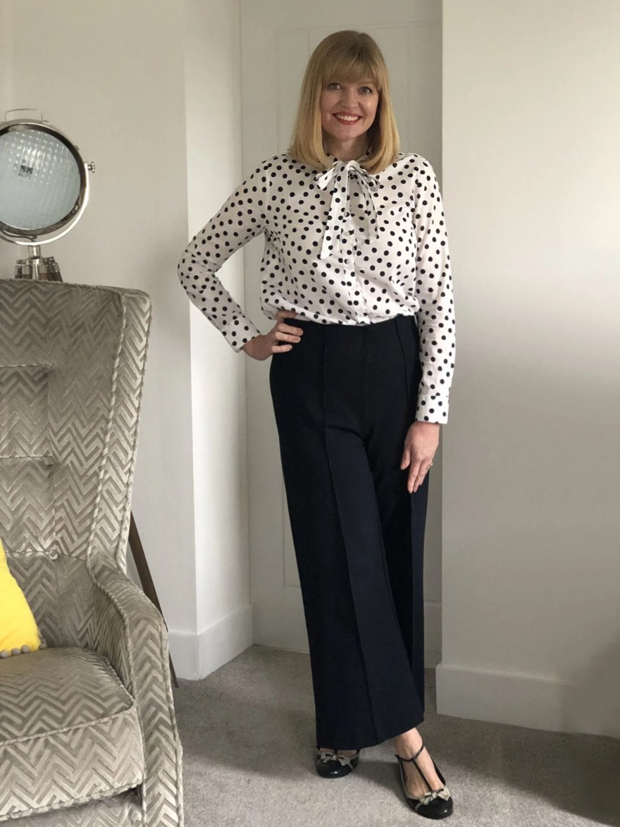 work outfit wide trousers and spotted blouse