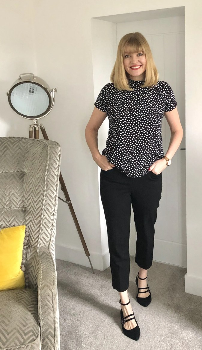 black spotted blouse and cropped trousers